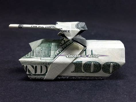 Tank Origami - money origami tank made with 100 bill money dollar