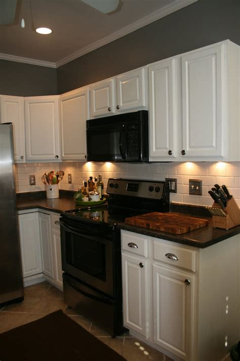 paint oak cabinets white i don t usually like white cabinets but with the appliances and