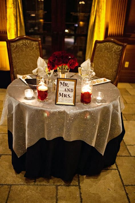 Sparkly silver and black linens with red roses and a Mr