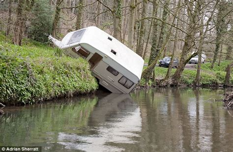 Caravan backs over a grass bank and into Little Avon river   Daily Mail Online