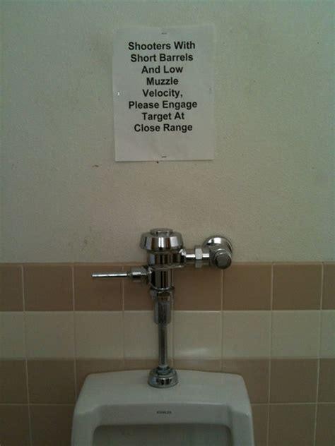 sign at a shooting range urinal