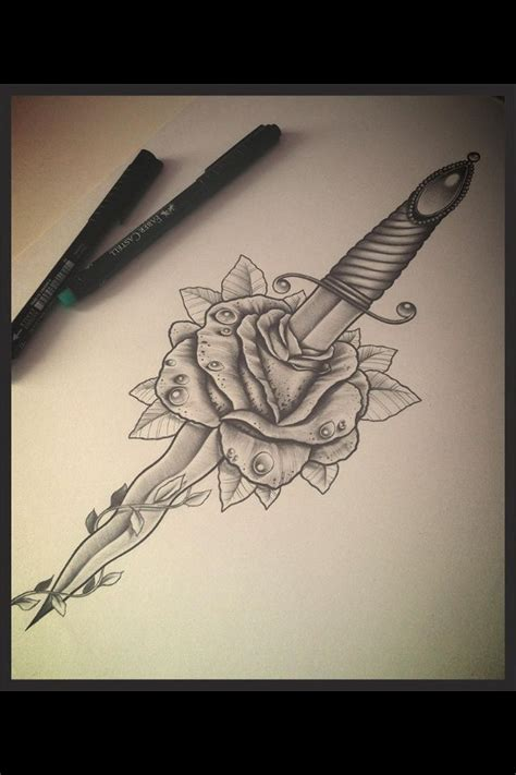 rose strength tattoo and dagger symbolizes the harsh reality of