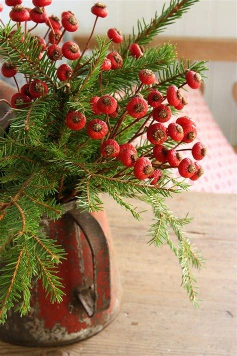 greenery berries in rustic pitcher christmas pinterest