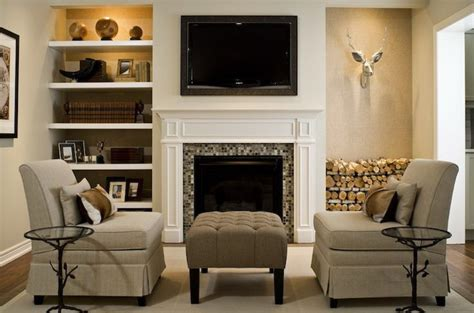 tv fireplace floating shelves on either side but