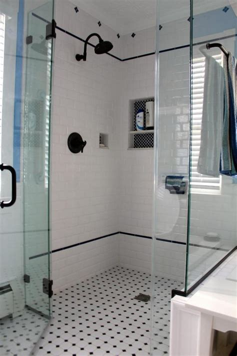 white subway tile bathroom shower  black deco liner