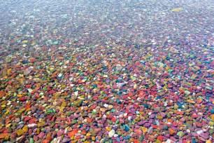 colored rocks the colored pebbles of lake mcdonald amusing planet