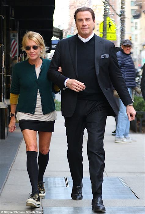 Micha Arm By M E Shop travolta suits up for nyc stroll with jewelry