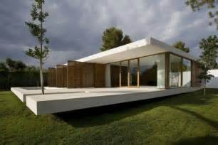minimalistic house contemporary house with glass wall and plane concrete