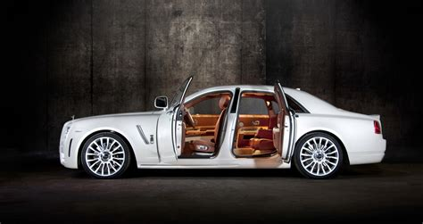 roll royce ghost white new mansory rolls royce ghost skips on the gold flakes