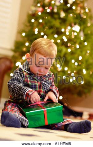 christmas presents 18month boy 18 month boy opening presents on morning stock photo royalty free image 5864397