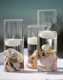 Cylinder vases floating candles and seashells for an ocean themed