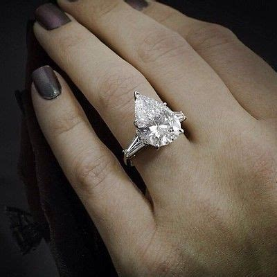 Side Ring pears baguette and engagement rings on