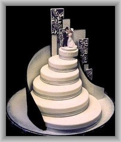 Black and White Wedding Cake with Bride and Groom Atop a