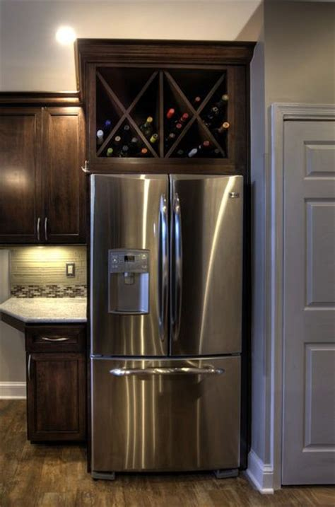wine storage above kitchen cabinets a custom wine rack above the refrigerator is a spin off on