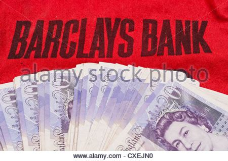 barclays bank currency on a barclays bank money bag stock photo royalty