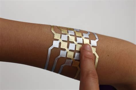 fake tattoo skin mit s duoskin turns temporary tattoos into on skin