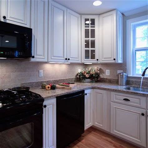 black refrigerator white cabinets on white kitchen with