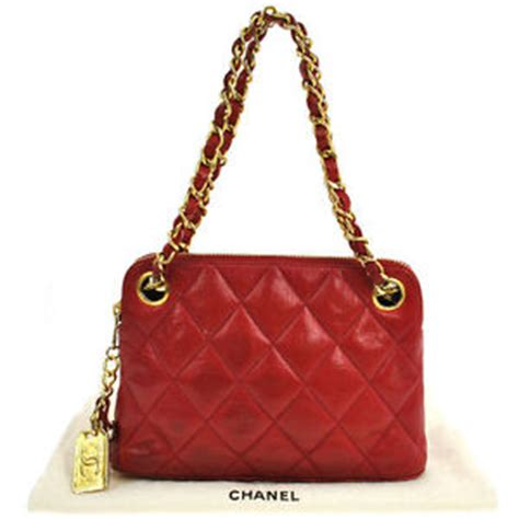 authentic chanel leather quilted with cc charm w dust