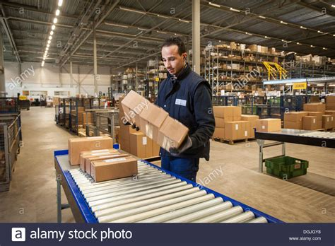 warehouse worker selecting cardboard boxes from