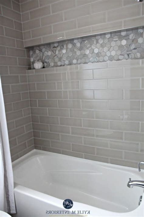 Bathroom Niche Ideas bathroom with bathtub and gray subway tile shower surround
