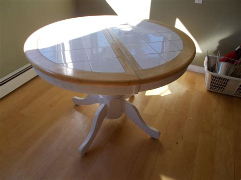 mechanically expandable kitchen table white tile and wood