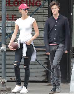 Karlie Kloss carries a football while stepping out with boyfriend Joshua Kushner   Daily Mail Online