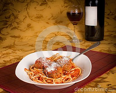 red wine with spaghetti and meatballs spaghetti and meatballs with red wine stock photo image