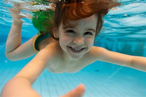 public pool pubes the girl smiles swimming under water in the pool stock