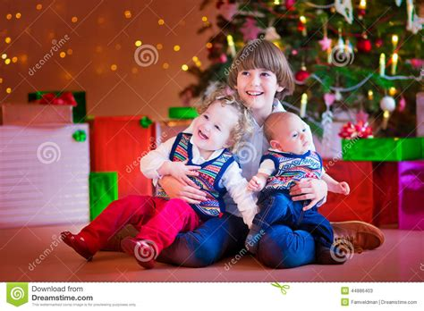 child and petprof xmas tree children a tree stock image image 44886403