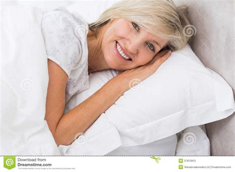 granny bed portrait of a mature woman resting in bed royalty free stock photo image 37813915