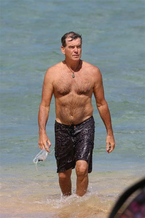 En Farel Hair Dryer shirtless brosnan has a bond moment as he