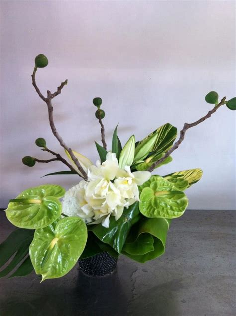 stylish floral arrangement  fresh fig branches green