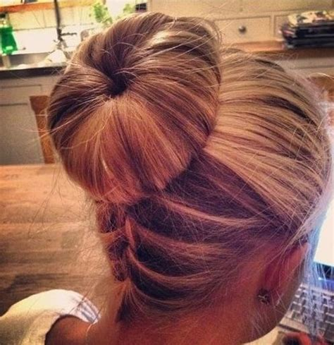 hair braided up into a bun style upside down braid bun hairstyle popular haircuts