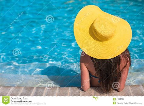 Backyard Vacations Pools Medicine Hat With Yellow Hat Relaxing At Swimming Pool In Stock