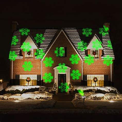 christmas lights projected on house turn your home into a dazzling laser show for the holidays your house will be central