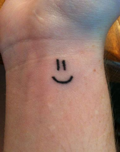 small smiley face tattoo show your side with these smiley tattoos