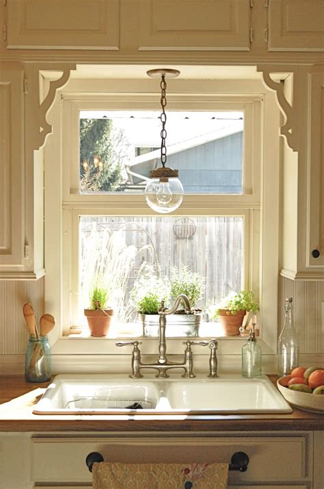 kitchen sink window ideas my kitchen s new old light fixture make over thrift