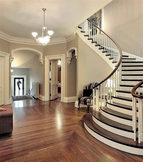 big white staircase beautiful wooden floors high here s a huge foyer that s nicely contained in layout a