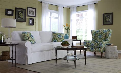 cottage style slipcover sofa with rolled arms and kick