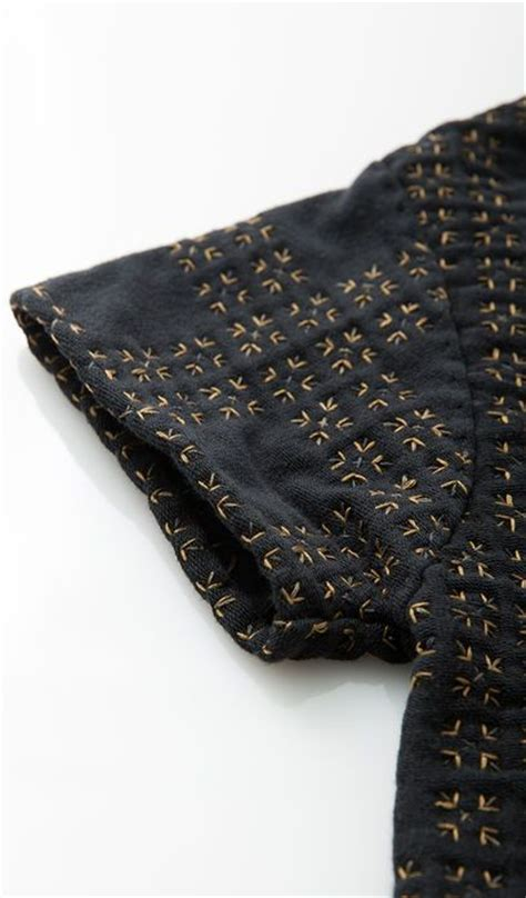 tile pattern jacket embroidered sleeve detail with micro tile pattern sewing
