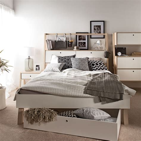spot bed with cabinet headboard in white and acacia