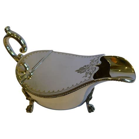 sauce boat or gravy warmer unusual antique english silver plated spoon warmer c 1880