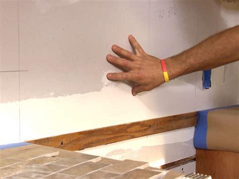 installing a new glass tile backsplash is a great diy