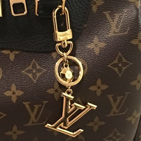 Bag Charm F21 louis vuitton lv facettes bag charm key holder m65216 from brown s closet on poshmark