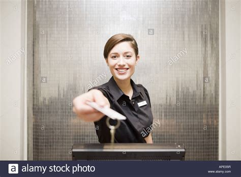 hotel front desk clerk handing keycard stock photo royalty free image 15761602 alamy