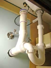Bathroom sink drain plumbing air vent p trap and pop up drain