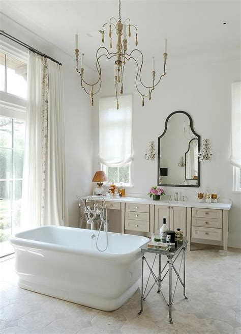 french bathroom mirrors french bathroom features a candle chandelier hanging over