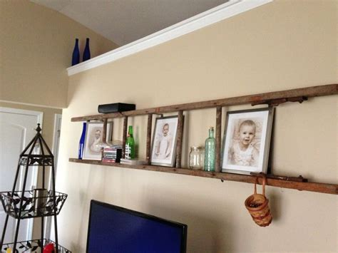 repurposed wooden ladder used quot l quot brackets to hang