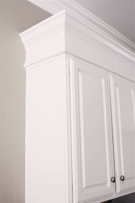 molding on top of kitchen cabinets the yellow cape cod making cabinets taller builder