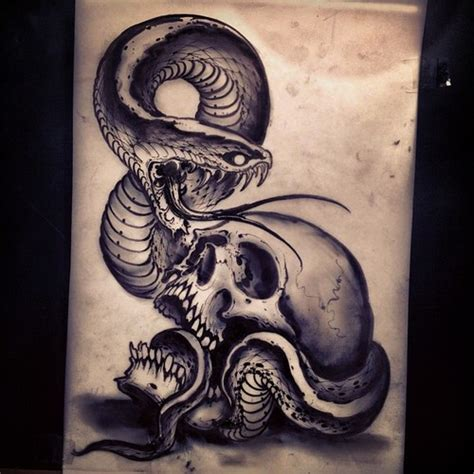snake tattoo guy london ontario artwork by joao bosco from the family business in london
